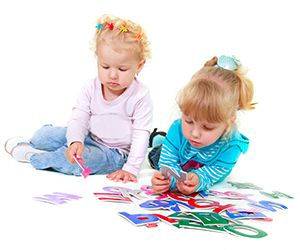 girls_playing_alphabet_letters_300x250