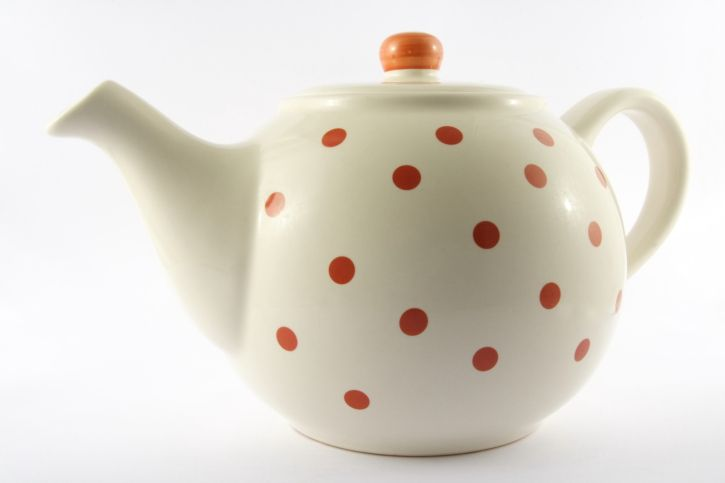 White teapot with orange polka-dots.