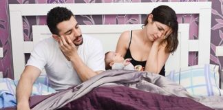 exhausted parents with newborn baby