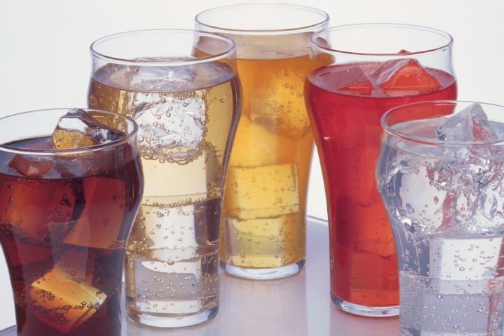 Glasses with ice and colourful sodas